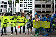 Extinction Rebellion activists protest outside the Department for Environment, Food and Rural Affairs Defra against the pollution of the UKs waterways on 5th August 2021 in London, United Kingdom. The activists were highlighting pollution of rivers by water companies and farms and the failure of the Environment Agency and Defra to protect waterways and to prosecute offenders.