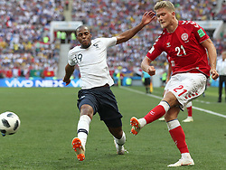 June 26, 2018 - Moscow, Russia - Andreas Cornelius (R) of Denmark vies with Djibril Sidibe of France during the 2018 FIFA World Cup Group C match between Denmark and France in Moscow, Russia, June 26, 2018. The match ended in a 0-0 draw. France and Denmark advanced to the round of 16. (Credit Image: © Cao Can/Xinhua via ZUMA Wire)