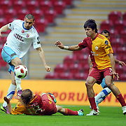 Galatasaray's Gokhan ZAN (R) and Trabzonspor's Burak YILMAZ (L) during their Turkish superleague soccer derby match Galatasaray between Trabzonspor at the TT Arena in Istanbul Turkey on Sunday, 10 April 2011. Photo by TURKPIX