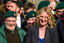© Licensed to London News Pictures.28/03/2017.London, UK. CLAIRE BLACKMAN (C), wife of Sergeant Alexander Blackman, surrounded by former Royal Marines and supporters as she leaves the Royal Courts of Justice in London, where a judge reduced the sentence for Sgt Blackman's manslaughter charge, meaning he will be free within weeks..Photo credit: Ben Cawthra/LNP