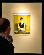 © Licensed to London News Pictures. 17/02/2012, London, UK. A man looks at Hockney's Self-portrait a lithograph in colours, 1954, on cartridge paper, signed David H. and indistinctly dated 1964. An auction of items by British artist David Hockney takes place at Christie's in London's South Kensington today, 17th February 2012. It features over 100 works by Hockney, including etchings, lithographs, drawings and photography. They are expected to sell for over £1m. The sale spans over 40 years of Hockney's career. Photo credit : Stephen Simpson/LNP