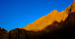 First rays of sunlight catch the top of the mountains in the Todra Gorge, Morocco<br /> <br /> (c) Andrew Wilson | Edinburgh Elite media