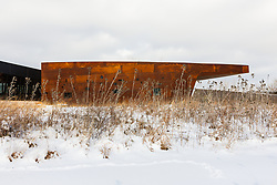 Trinity River Audubon Center building and grasses after winter snow, Dallas, Texas, USA.