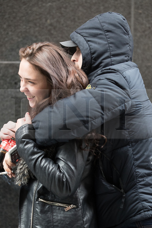© Licensed to London News Pictures . 08/11/2016 . Manchester , UK . ROBERT MOLLOY (right , hiding behind woman) arrives at Manchester Magistrates' Court . Manchester Metropolitan University sport lecturer and US Army veteran Juan Jasso , originally from Texas, was the victim of racial abuse on a Manchester tram . The incident , recorded on a passenger's mobile phone and seen widely on social media , took place on on 28th June 2016 . Aaron Cauchi (born 27/07/97) of Brydon Close in Salford is charged with two public order offences and assault . Robert Molloy (born 24/05/96) of no fixed address is charged with racially aggravated assault , two assaults and a public order offence . A 16-year-old from Pendleton in Salford is charged with two public order offences and assault. Photo credit : Joel Goodman/LNP