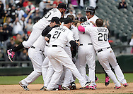 CHICAGO - MAY 10:  Gordon Beckham #15 of the Chicago White Sox celebrates with teammates after hitting a game winning, walk-off single against the Cincinnati Red on May 10, 2015 at U.S. Cellular Field in Chicago, Illinois.  (Photo by Ron Vesely)   Subject:   Gordon Beckham