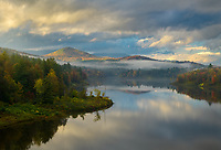 Sunset refelctions and fall color at Wrightsville Reservoir in northern Vermont, USA