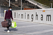 As numbers of Covid-19 cases in Birmingham have dramatically risen in the past week, increased lockdown measures have been announced for Birmingham and other areas of the West Midlands,  people wearing face masks pass near the sign for Birmingham New Street / Grand Central station in the city centre on 12th September 2020 in Birmingham, United Kingdom. With the rule of six also being implemented the Birmingham area has now be escalated to an area of national intervention, with a ban on people socialising with people outside their own household, unless they are from the same support bubble.