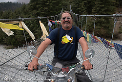 Beanre (Kevin Doebler) riding a suspension bridge on day-6 of our Himalayan Heroes adventure riding from Muktinath to Tatopani, Nepal. Sunday, November 11, 2018. Photography ©2018 Michael Lichter.