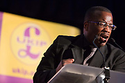 Winston McKenzie a Jamaican, former boxer and UKIP candidate for Croydon, addresses a UKIP meeting. UKIP, The UK Indepenence Party, campaigns as an anti racist party whilst against immigration and the EU. The front rows of the hall are filled with multi ethnic supporters to reinforce the message.