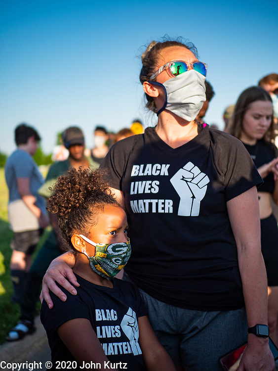 17 JUNE 2020 - NORWALK, IOWA: A woman and her daughter at a Black Lives Matter march in Norwalk. About 400 supporters of Black Lives Matter marched through Norwalk, IA, an upper class suburb of Des Moines Wednesday. Norwalk has a population of about 10,000 and, according to the US Census Bureau, is 97 percent white. The marchers were protesting police violence against people of color. The march was a reaction to the police killing of George Floyd in Minneapolis in May. The march was peaceful.        PHOTO BY JACK KURTZ