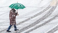 28.04.2017, Kaprun, AUT, Wintereinbruch in Salzburg, im Bild eine Frau spaziert mit einem Schirm auf der angeschneiten Strasse // a woman walks with an umbrella on the snow Covered road in Kaprun, Austria on 2017/04/28. EXPA Pictures © 2017, PhotoCredit: EXPA/ JFK