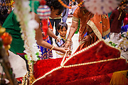 10 AUGUST 2012 - PHOENIX, AZ: A boy dressed as Krishna makes an offering at a shrine during Janmashtami celebrations at Ekta Mandir, a Hindu temple in central Phoenix. Janmashtami is the Hindu holy day that celebrates the birth of Lord Krishna. Hindu communities around the world celebrate the holy day. In Arizona, most of the Hindu temples in the Phoenix area have special celebrations of the day.  PHOTO BY JACK KURTZ