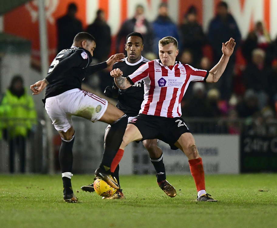 Lincoln City's Harry Anderson vies for possession with Accrington Stanley's Ben Richards-Everton<br /> <br /> Photographer Chris Vaughan/CameraSport<br /> <br /> The EFL Sky Bet League Two - Lincoln City v Accrington Stanley - Saturday 16th December 2017 - Sincil Bank - Lincoln<br /> <br /> World Copyright © 2017 CameraSport. All rights reserved. 43 Linden Ave. Countesthorpe. Leicester. England. LE8 5PG - Tel: +44 (0) 116 277 4147 - admin@camerasport.com - www.camerasport.com