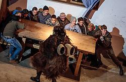 01.12.2016, Riedlhof, Lienz, AUT, Osttiroler Krampustage im Bild Mitglieder der Krampusgruppe NIKRAMO beim traditionellen Osttiroler Tischziachn // Members of the Krampusgroup NIKRAMO during the traditional Osttiroler table drawing. Krampus a mythical creature that, according to legend, accompanies Saint Nicholas during the festive season. Instead of giving gifts to good children, he punishes the bad ones, Lienz, Austria on 2016/12/01. EXPA Pictures © 2016, PhotoCredit: EXPA/ JFK