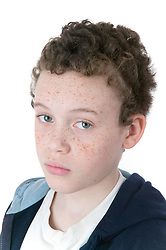 Little boy looking thoughtful,