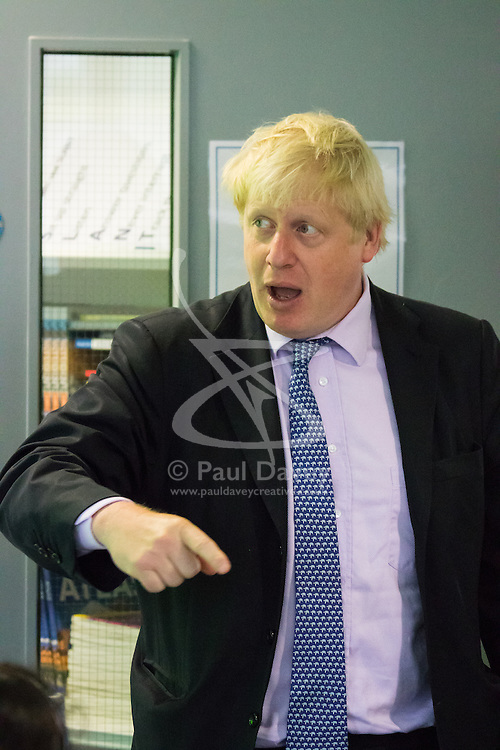 Michaela Community School, Wembley, London, June 23rd 2015. Mayor of London Boris Johnson visits the Michaela Community School, a Free School in Wembley that started taking students in September2014 after battling a certain amount of resistance from locals and unions. During the visit Head Teacher Katharine Birbalsingh took the Mayor on a tour of the school before he participated in a history lesson, prior to sitting down with pupils for brunch. PICTURED: Boris Johnson, an expert on ancient Greek and Roman history participates enthusiastically in a class on the subject.