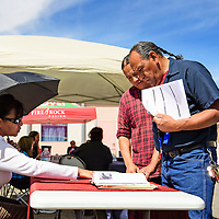Jaime Duran and Gerald Benally speak with Florence Billie from Community Outreach and Patient Empowerment (COPE) at a job fair hosted by New Mexico Workforce Connections, Thursday, August 30, 2018 in Gallup.