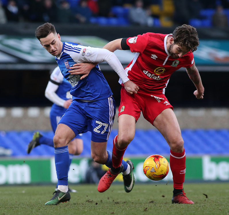 Blackburn Rovers' Charlie Mulgrew battles with Ipswich Town's Tom Lawrence<br /> <br /> Photographer David Shipman/CameraSport<br /> <br /> The EFL Sky Bet Championship - Ipswich Town v Blackburn Rovers - Saturday 14th January 2017 - Portman Road - Ipswich<br /> <br /> World Copyright © 2017 CameraSport. All rights reserved. 43 Linden Ave. Countesthorpe. Leicester. England. LE8 5PG - Tel: +44 (0) 116 277 4147 - admin@camerasport.com - www.camerasport.com