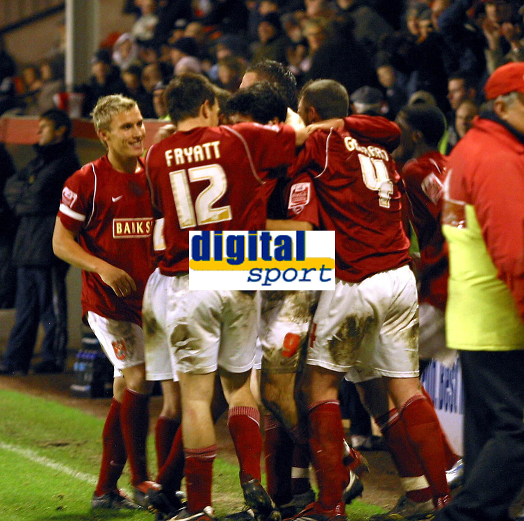 Photo: Dave Linney.<br />Walsall v Yeovil Town. The FA Cup. 03/12/2005.<br />Jorge  Leitao(Centre) celebrates his goal, which also earned him a booking for celebrating with the crowd