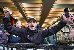 © Licensed to London News Pictures. 12/12/2020 Manchester, UK. A protester holds  shouts slogans  during an anti-lockdown protest in Manchester.  Gardens in Manchester. Hundreds  of protesters gathered at Piccadilly Circus to protest against Covid-19 restrictions. Photo credit: Ioannis Alexopoulos/LNP