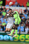 Kelechi Iheanacho of Manchester city jumps for a header with Jordi Amat of Swansea city (l). Barclays Premier league match, Swansea city v Manchester city at the Liberty Stadium in Swansea, South Wales on Sunday 15th May 2016.<br /> pic by Andrew Orchard, Andrew Orchard sports photography.