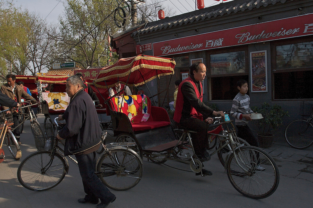 Rickshaws circle the Shichahai area near the Yinding Bridge in Beijing,China.