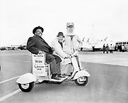 Y-570514-03. Count Basie on Vespa at Portland Airport, May 14, 1957.