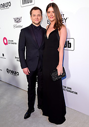 Taron Egerton and Emily Thomas attending the Elton John AIDS Foundation Viewing Party held at West Hollywood Park, Los Angeles, California, USA.