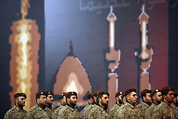 Members of Hezbollah's elite military wing, the Islamic Resistance of Lebanon, prepare to carry the coffin of slain militant commander Imad Mugniyeh in Beirut, Lebanon on Feb. 14, 2008. Imad Mugniyeh was killed in a mysterious car bombing in Damascus, Syria. Mugniyeh a.k.a. Hajj Radwan, was among the most feared terror operatives in the world. The Islamic Resistance of Lebanon rarely appears dressed in uniform publicly.