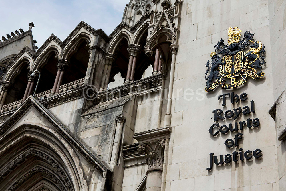 The sign outside The Royal Courts of Justice, commonly called the Law Courts, is a court building in London which houses both the High Court and Court of Appeal of England and Wales. London, UK.