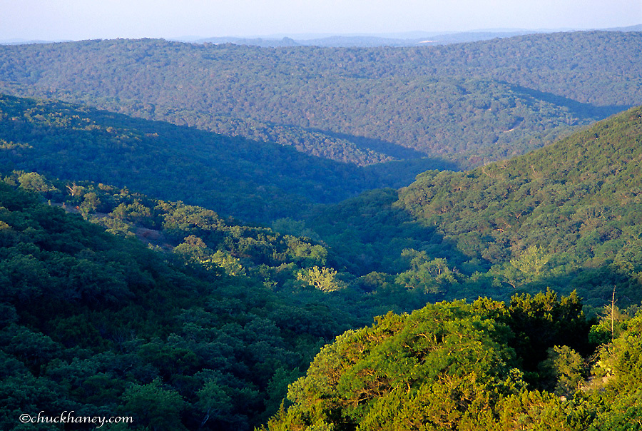 Rolling hills covered with trees in the Texas Hill Country in Vanderpool