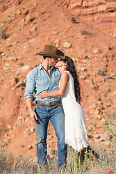cowboy and a girl kissing outdoors