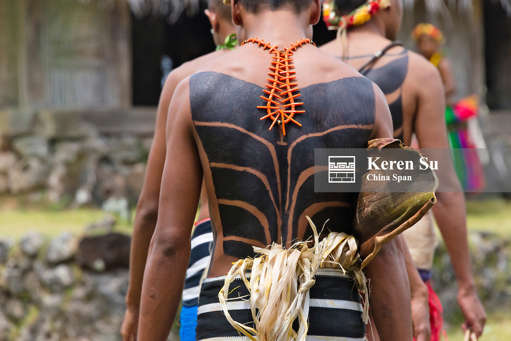 Yapese men with tattoo on the back at Yap Day Festival, Yap Island, Federated States of Micronesia
