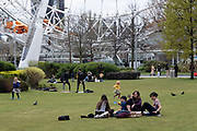People hanging out at the Jubillee Park and Garden on the South Bank on 13th April 2021 in London, United Kingdom. The South Bank is a significant arts and entertainment district, and home to an endless list of activities for Londoners, visitors and tourists alike.