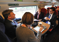 © Licensed to London News Pictures. 16/03/2012. London, UK. (left to right) Ed Balls, Yvette Cooper, Ed Miliband and Harriet Harmen (back  to camera) Leader of the Labour Party, Ed Miliband and members of his Shadow Cabinet travel to Labour's Youth Conference in Coventry this morning, 16 March 2012, by train from London Euston Station. Photo credit : Stephen SImpson/LNP