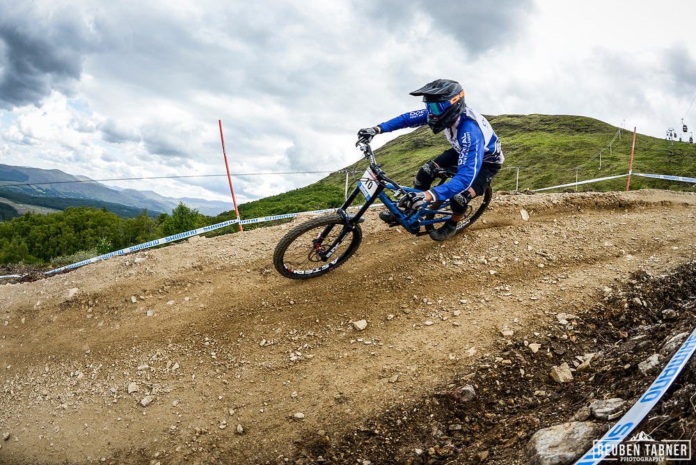 Benoit Coulanges from Dorval AM Nicolai rides the rails of the Fort William downhill track during practise at the UCI Mountain Bike World Cup.