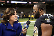 NBC Sports sideline analyst Michele Tafoya  does a postgame television interview with a smiling New Orleans Saints running back Mark Ingram (22) after the NFL week 8 regular season football game against the Green Bay Packers on Sunday, Oct. 26, 2014 in New Orleans. The Saints won the game 44-23. ©Paul Anthony Spinelli