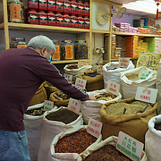 Man buying spices in spice shop in Hong Kong