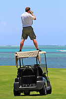 Paul Severn on top of a golf buggy