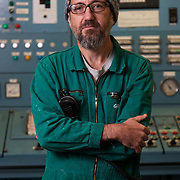 Freddy, from Argentina. 2nd engineer. In the engine controle Room. Photographed at sea on patrol in the North Sea.