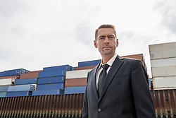 Portrait of a businessman standing at a harbour, Hamburg, Germany