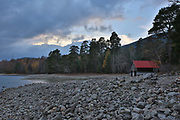 An isolated hut at Loch Vaa on the 6th November 2018 in Aveimore, Scotland in the United Kingdom. Behind the pinewoods, just off the A95 between Aviemore and Boat of Garten is the lesser known Loch Vaa.
