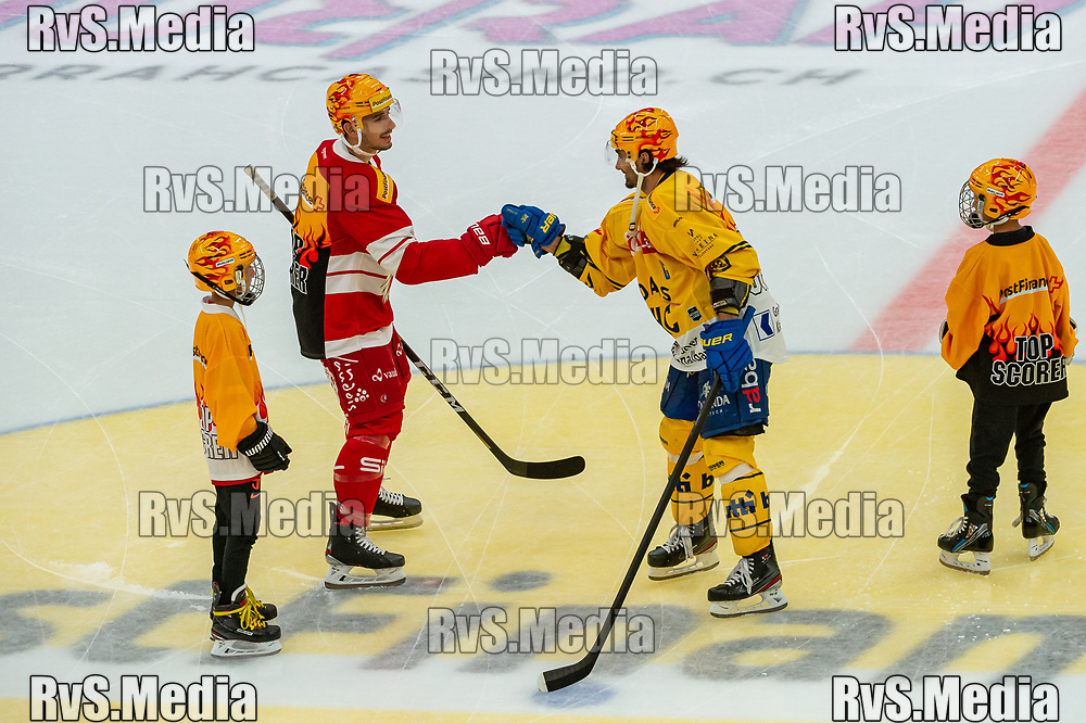 LAUSANNE, SWITZERLAND - SEPTEMBER 24: TopScorer Damien Riat #9 of Lausanne HC greets with TopScorer Andres Ambuhl #10 of HC Davos prior the Swiss National League game between Lausanne HC and HC Davos at Vaudoise Arena on September 24, 2021 in Lausanne, Switzerland. (Photo by Robert Hradil/RvS.Media)