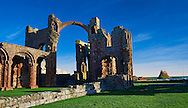 The Anglo Saxon Romanesque Abbey ruins of Holy Island, Lindisfarne, Northumbria, England .<br /> <br /> Visit our MEDIEVAL PHOTO COLLECTIONS for more   photos  to download or buy as prints https://funkystock.photoshelter.com/gallery-collection/Medieval-Middle-Ages-Historic-Places-Arcaeological-Sites-Pictures-Images-of/C0000B5ZA54_WD0s