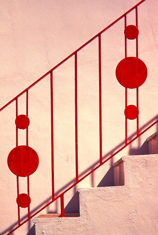 A Miami Modern railing on a small Miami Beach apartment house.