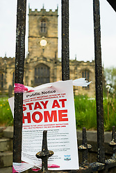 Signs of Covid-19 Saint Marys Church Ecclesfield Sheffield a  Sheffield council notice tells parishoners to Stay at Home<br /> 24 April 2020<br /> <br /> www.pauldaviddrabble.co.uk<br /> All Images Copyright Paul David Drabble - <br /> All rights Reserved - <br /> Moral Rights Asserted -