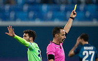 SAINT PETERSBURG, RUSSIA - NOVEMBER 04: Match referee Artus Dias issues a yellow card during the UEFA Champions League Group F stage match between Zenit St. Petersburg and SS Lazio at Gazprom Arena on November 4, 2020 in Saint Petersburg, Russia. (Photo by MB Media)