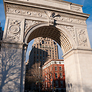 Arch over dramatic skies in Washington Square Park from 5th avenue, Manhattan, New York City