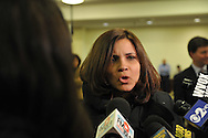 Nassau County Legislature, controlled by Republicans, votes along party lines to consolidate 8 police precincts into 4, on Monday, March 5, 2012, at Mineola, New York, USA. Milagros Vicente (center), a North Valley Stream resident, spoke against closing precincts during meeting.
