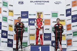 August 18, 2018 - Towcester, United Kingdom - JURI VIPS of Estonia and Team Motopark, MICK SCHUMACHER of Germany and Prema Theodore Racing and JONATHAN ABERDEIN of South Africa and Team Motopark are seen on the podium after the 2018 FIA Formula 3 European Championship race 2 at Silverstone Circuit in Towcester, United Kingdom. (Credit Image: © James Gasperotti via ZUMA Wire)